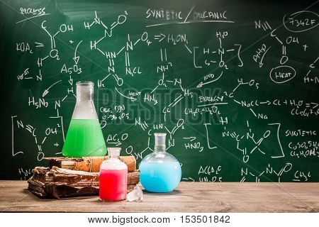 Closeup of school laboratory with books and beakers