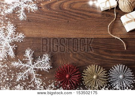 Christmas Background With Decorations And Gift Boxes On Wooden Board. Blue Sparkly Holiday Backgroun