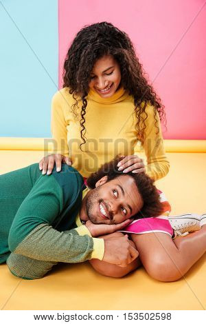 Happy tender african american young couple relaxing together