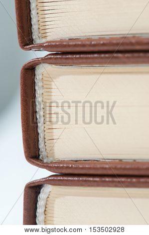 Three books turned back side shot close-up.