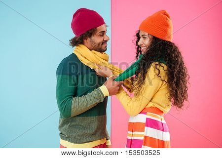 Smiling african american young couple standing and flirting