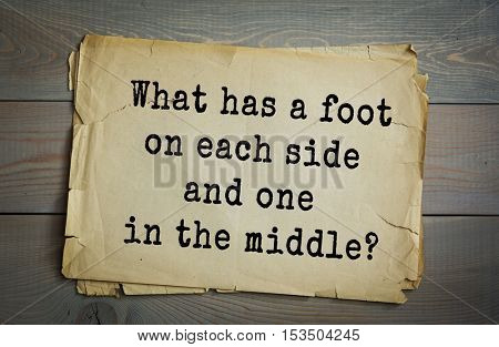 Traditional riddle. What has a foot on each side and one in the middle?( A yardstick.)