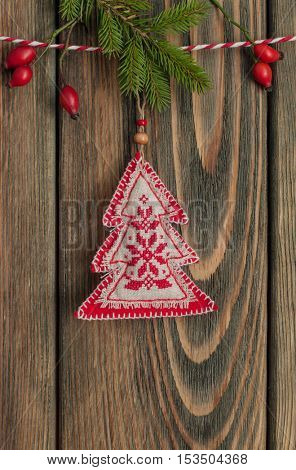 Christmas tree hanging over wooden background.