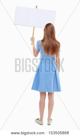 Back view woman showing sign board. man holds information plate. Rear view people collection. backside view of person. Isolated over white background. Skinny girl in a blue dress holding a poster.
