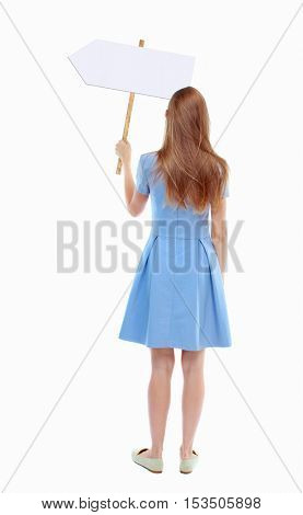 Back view woman showing sign board. man holds information plate. Rear view people collection. backside view of person. Isolated over white background. Skinny girl in a blue dress holding a pointer.