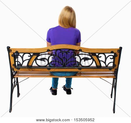 Back view of a woman sitting on a bench.  girl  watching. Rear view people collection.  backside view of person.  Isolated over white background. Girl thoughtfully looking into the distance.