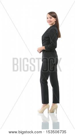 Full-length profile of businesswoman looking on camera, isolated