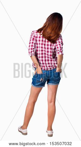 back view of standing young beautiful  woman.  girl  watching. Rear view people collection.  backside view of person.  The girl in shorts standing with his hands in his pockets