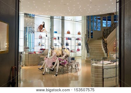 HONG KONG - JANUARY 27, 2016: Dior boutique in Hong Kong at night. Christian Dior SE, commonly known as Dior, is a French luxury goods company.