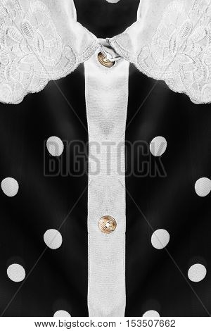 White collar on black silk blouse as a background