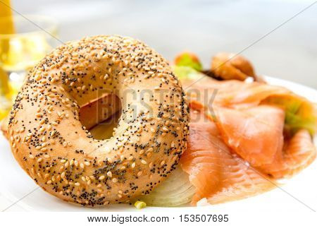 Bagel with Fresh Salmon and fresh lettuce on table