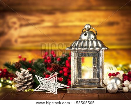 Christmas still life with lamp garland and balls on wooden board copyspace