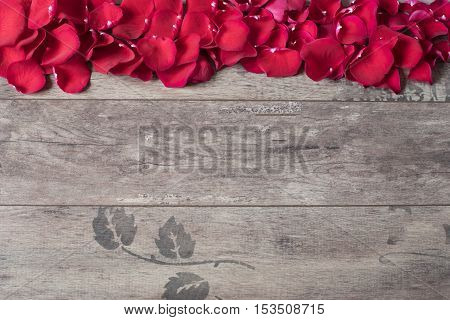 Red Rose Petals On The Wooden Background. Rose Petals Border On A Wooden Table. Top View, Copy Space