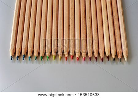 A row of natural wooden color pencils