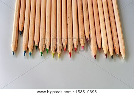 Staggered row of natural wood color pencils