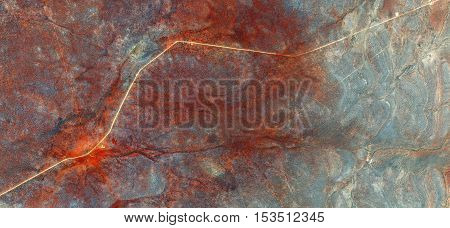 imaginary roads, fantasy colors human work, reds, broken lines, Abstract photography of landscapes of deserts of Africa from the air