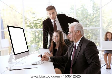 Business training concept. Colleagues looking at computer monitor in office