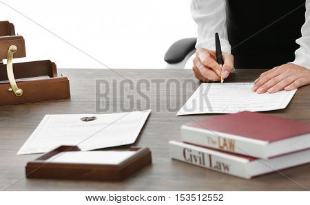 Female lawyer signing documents in office, close up view