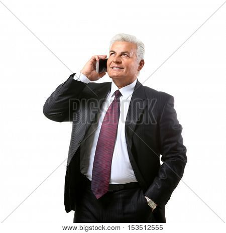 Successful mature businessman with mobile phone isolated on white