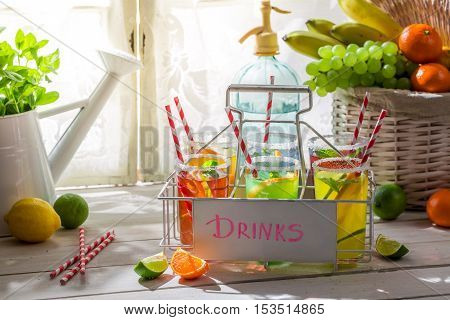 Sweet drink with lemon and orange on wooden table