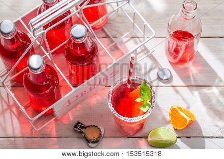Cold Orangeade In Bottle With Citrus Fruit