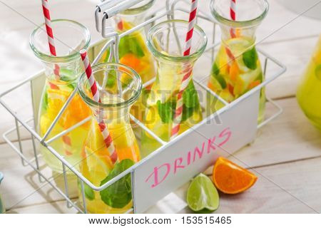 Summer lemonade with citrus fruits on wooden table