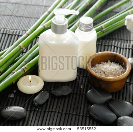 Towel and stones and oil,grove on bamboo mat