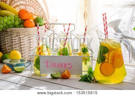 Summer drink with citrus and sugar on wooden table