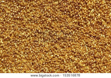 image filled with small round stones in gold