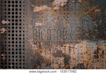 The vintag rusty grunge steel decorated by drilling a wall textured background