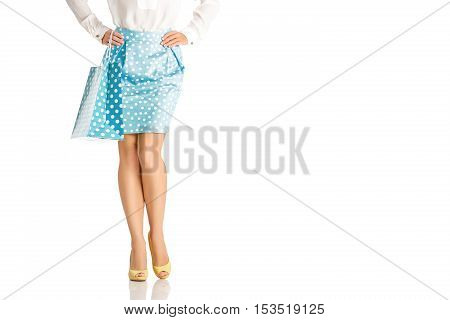 people, sale, black friday concept -  woman in blue skirt with shopping bag isolated on white background