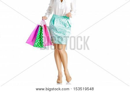 people, sale, black friday concept -  woman in green skirt with shopping bags isolated on white background
