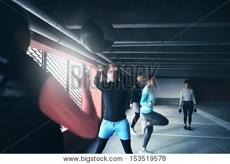 Group of people exercising together with medicine ball and skipping rope