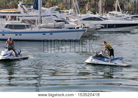 ALICANTE SPAIN - AUGUST 31: men driving jet skis in the port of alicante. Picture taken on August 31 2016 in Alicante spain.