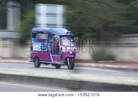 traditional tuk-tuk the unique from Hua Hin Thailand in motion blur.