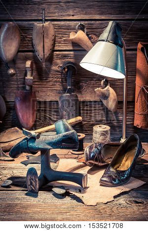 Vintage Shoemaker Workshop With Tools, Leather And Shoes