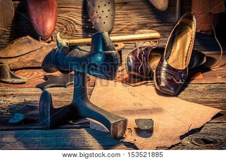 Vintage Shoemaker Workplace With Tools, Leather And Shoes