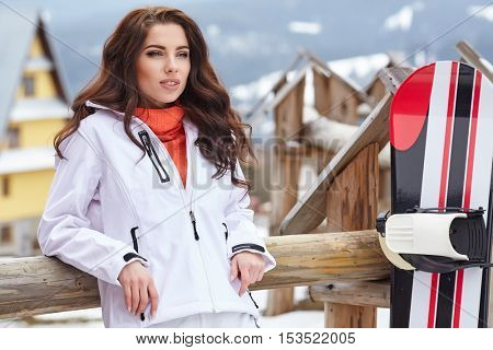 Woman snowboarder . winter day. Beautiful girl on snobord in the snow.