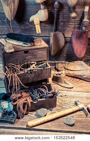 Vintage Cobbler Workplace With Brush And Shoes
