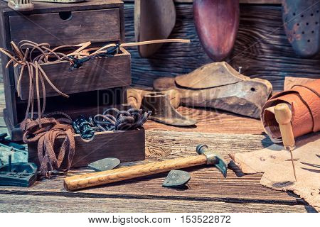 Old Shoemaker Workshop With Brush And Shoes