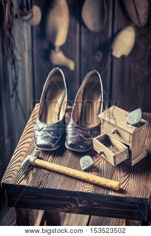 Old Cobbler Workshop With Brush And Shoes