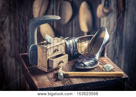 Old Cobbler Workshop With Tools, Leather And Shoes