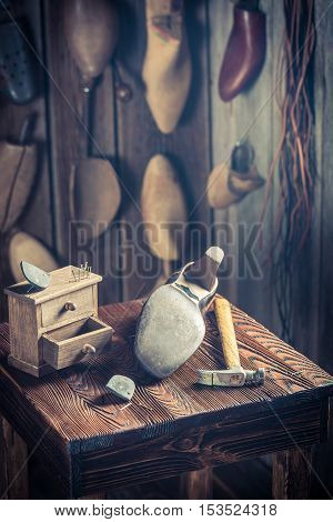 Aged Shoemaker Workplace With Brush And Shoes