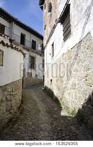 CANDELARIO, SPAIN - AUGUST 11, 2016: Stone steep street in the picturesque village of Candelario in the province of Salamanca Spain.