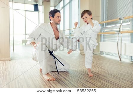 young, beautiful, successful multi ethical karate kids in karate position