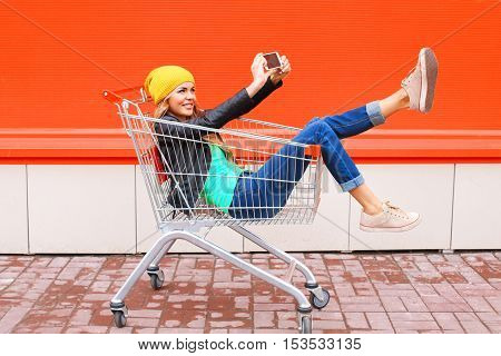Fashion Pretty Cool Young Girl In Trolley Cart Taking Picture Self Portrait On Smartphone Wearing Bl