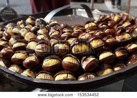 street food . closeup of roast chestnuts.