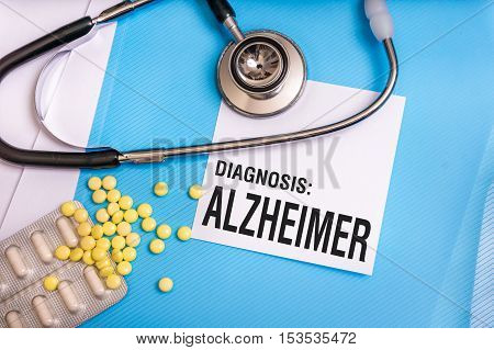 Alzheimer Word Written On Medical Blue Folder With Patient Files