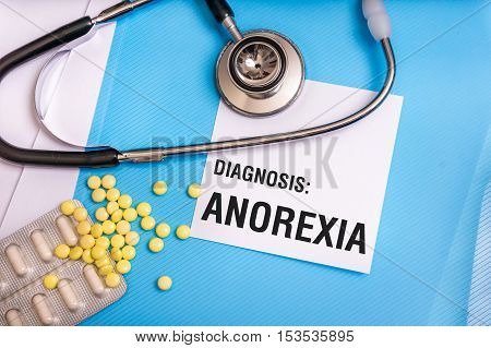 Anorexia Word Written On Medical Blue Folder With Patient Files