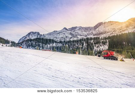 Sunny winter day on the ski slope - Perfect destination for a winter vacation the Austrian Alps with their peaks fir forests and ski slopes all covered by snow. Image taken in Ehrwald Austria.